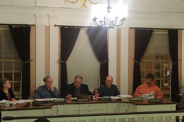 Dwight Douglas, center, presided over his final meeting at Peekskill Planning Commission Chair Wednesday night.