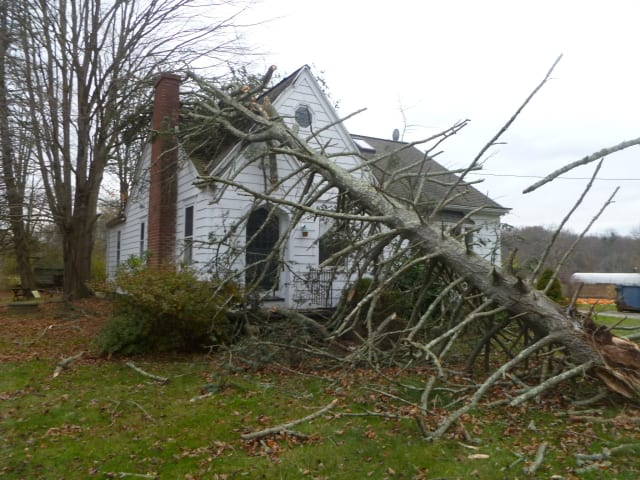 Weston area homes are hit with tree damage during Hurricane Sandy.