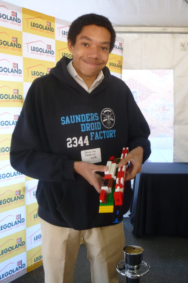 Yonkers resident Griffith Derrick built a train on railroad tracks during Saturday's lego competition.