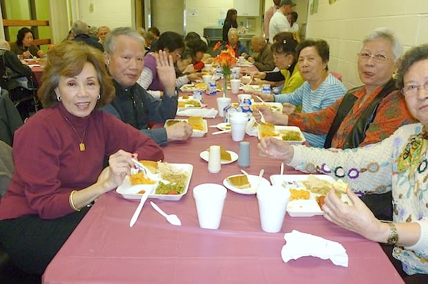 Attendees enjoy their lunch at the Thanksgiving event held at the Theodore D. Young Community Center in Greenburgh on Tuesday afternoon.