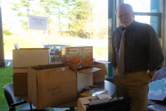 Paul Anderson-Winchell, executive director of the Grace Church Community Center in White Plains, with food donations being sorted for Thanksgiving deliveries.
