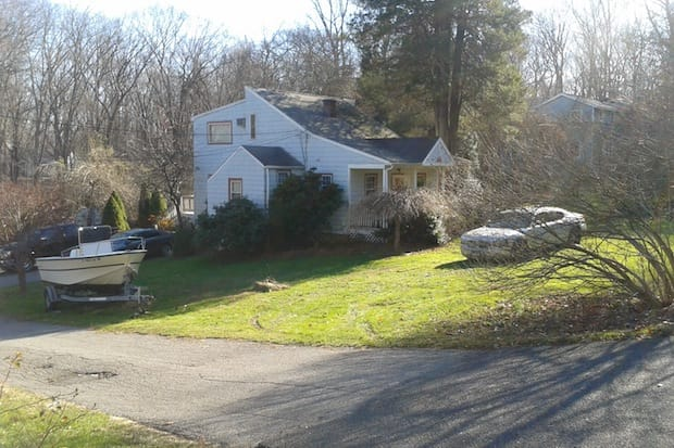 A man suffered a life-threatening gunshot wound in this home on Grumman Avenue in Wilton Monday, police said