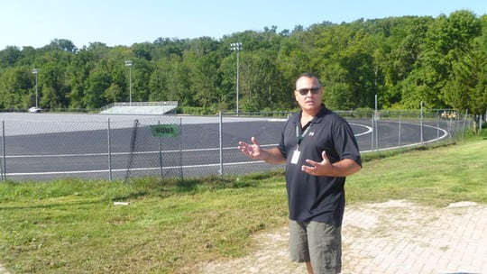 Tom Cole, Yorktown's assistant schools superintendent for business, tours the construction site in September.