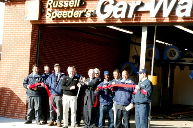 First Selectman Michael Tetreau cuts the ribbon on Russell Speeder's Car Wash new location in Fairfield earlier this month.