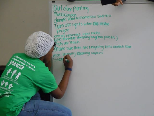 A member of the Yonkers YWCA Green Team outlines the steps to creating a more green approach at the nonprofit Saturday as part of the Green Team's kick-off event.