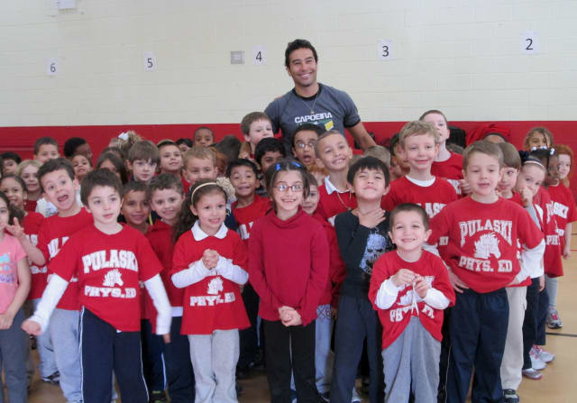 """Brett Hoebel, fitness trainer for the reality television show, """"The Biggest Loser,"""" talked to Yonkers students about ways to build inner-strength and confidence."""
