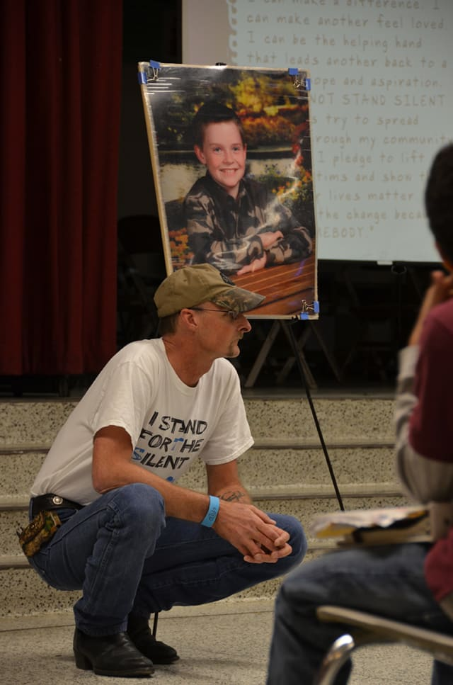 Kirk Smalley speaks Thursday at an AMD assembly featuring an anti-bullying program known as Stand For The Silent.