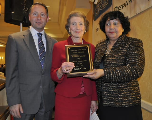 County Executive Robert Astorino poses with Reina Schiffrin and Scarsdale honoree Carol Stix.