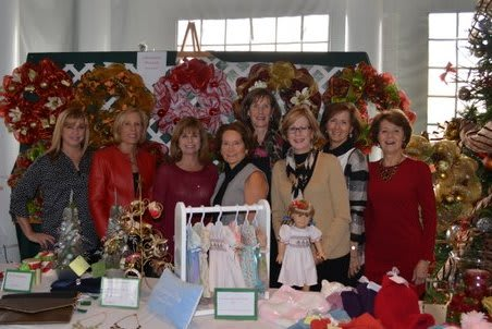 Jill Pankosky, Barbara Kelly, Gail Jones, Diane Musicaro, Kathy Lavery, Chris Falco, Laurie McGrath and Nancy Powell at the Country Club of Darien's annual Holiday Luncheon and Boutique.