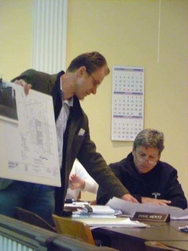 Architect Viktor Solarik shows Mount Kisco Planning Board member Doug Hertz the site plan for new restaurant Little Crepe Street at the board's Tuesday meeting.