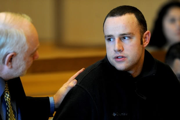 Aaron Ramsey of Wilton sits with his defense lawyer Howard Ehring at the hearing in Stamford where he was found to be not guilty by reason of mental illness by a three-judge panel in the death of his father.