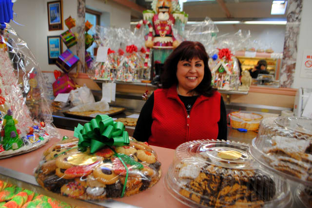 Rose Sanca, owner of Homestyle Desserts Bakery, stands behind the counter of the retail side of her Cortlandt bakery.
