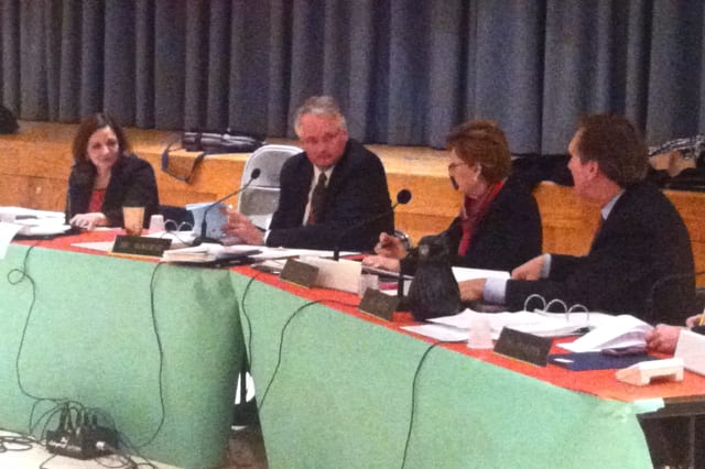 Greenwich Superintendent of Schools William McKersie, second from left, listens to a question from school board member Peter Sherr during Thursday's budget meeting.