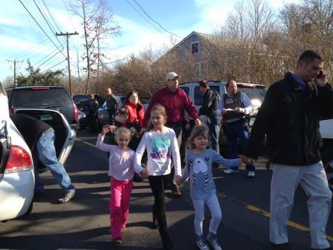 The scene outside Sandy Hook Elementary School in Newtown, Conn., Friday after a gunman opened fire inside the school.