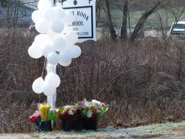 The investigation into the shooting at the Sandy Hook School in Newtown will likely take weeks, state police said.