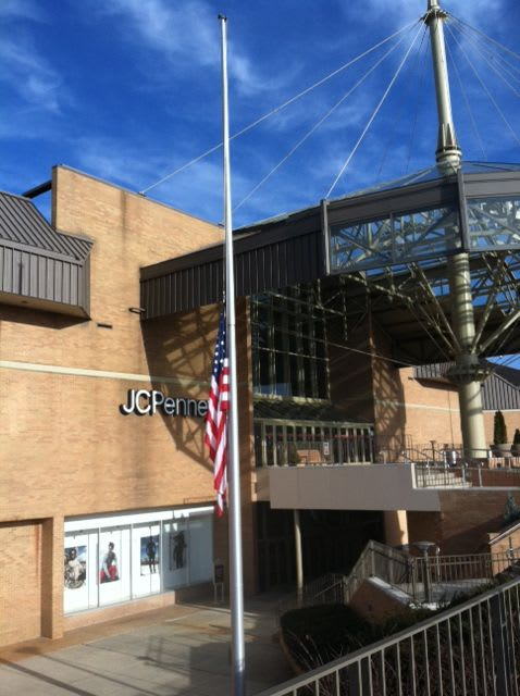 A flag at the Danbury mall at half-staff this weekend in memory of the victims of the Newtown school shooting.