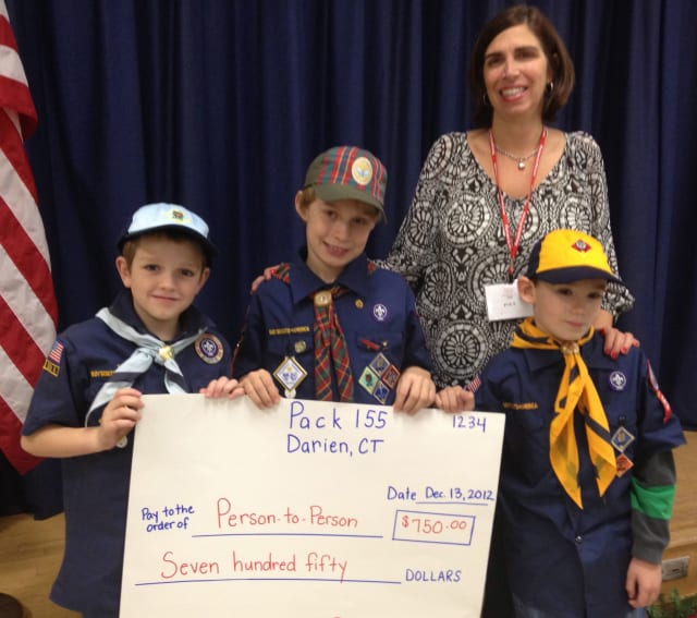 Luke Riordan, Jacob Grimm and Brenton Ingulli, the top popcorn sellers of Darien's Cub Scout Pack 155 with Pat Cage of Person-to-Person.