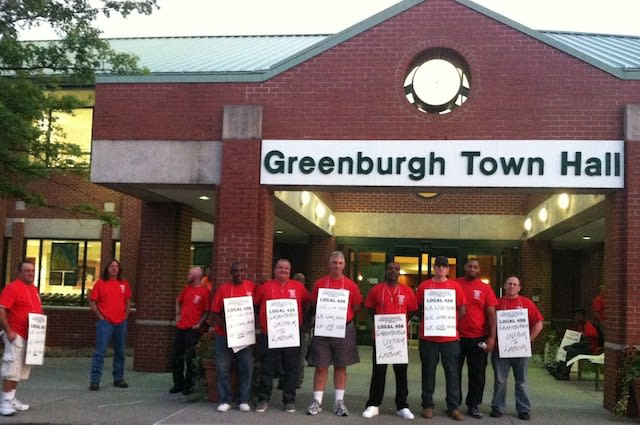 Greenburgh Department of Public Works employees picket a town board meeting in September. The Teamsters union finally settled a contract with the town board.
