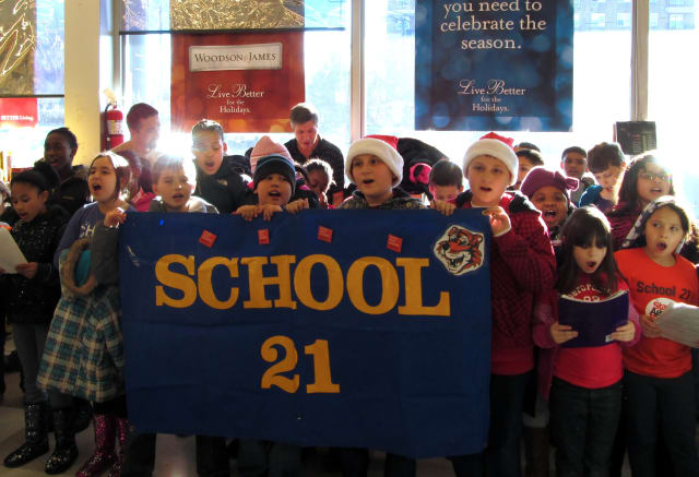 Students from Yonkers School 21 marched several blocks from their school to a local supermarket to sing holiday songs the week before Christmas.