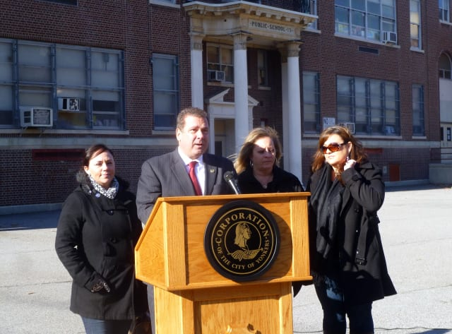 "Mayor Mike Spano and members of the Yonkers Council of PTA/PTSAs announced the start of the ""Pledge For Healthy School Bus Stops"" campaign Wednesday outside School 13 ."