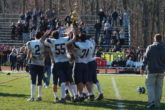 The Weston Trojans celebrate their win over Joel Barlow that qualified them for the Class M state championships.