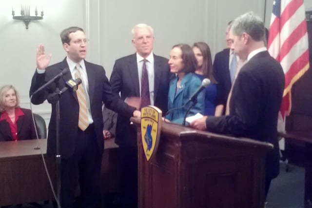 David Buchwald (hand raised) is sworn in as the new Assembly member for the 93rd District.
