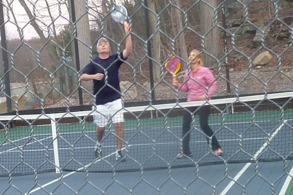 Dave and Sheila Mueller of Darien compete in the Connecticut State Mixed paddle tennis tournament last year.