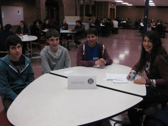 Horace Greeley juniors Joao Carrvao, left, Max Smiley and Josh Turner sit down with Horace Greeley graduate Aemilia Phillips, who now is a freshman at Harvard.