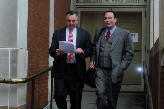 Former White Plains Mayor Adam Bradley (left) walks out of City Court with his lawyer, Randall Cutler.