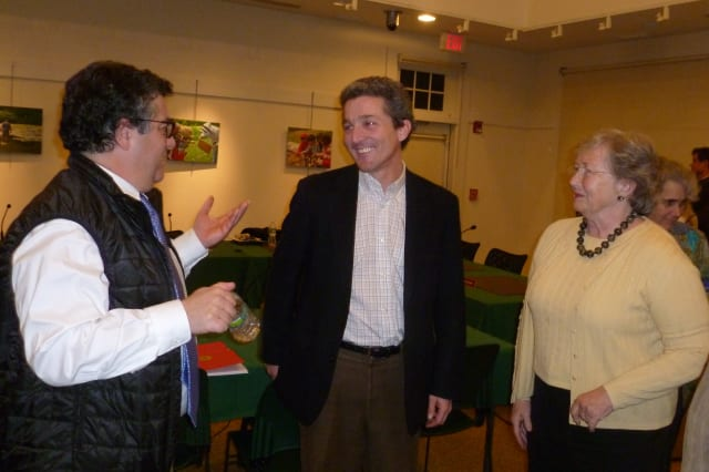 John Engel, center, is elected to the New Canaan Town Council on Thursday. He is flanked by First Selectman Robert Mallozzi III and Councilwoman Penny Young.