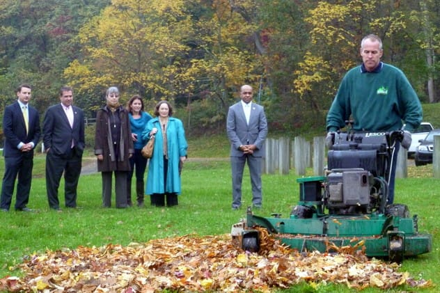 Tim Downey, owner of Aesthetic Landscape Care Inc., shows Yonkers officials how leaf mulching works during an October demonstration in Redmond Park.