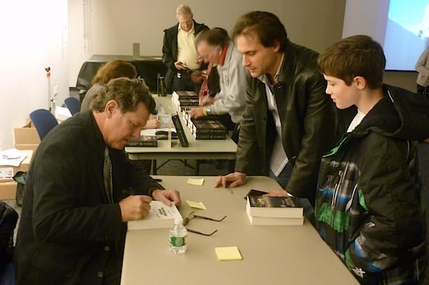 """Paul Lieberman,at left, signs copies of his book """"Gangster Squad"""" for Rocco Dapice and his son, R.J., at the Greenburgh Public Library on Tuesday night."""