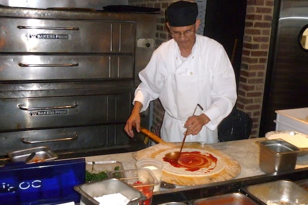 Tony Diaz spreads sauce on pizza dough at Racanelli's New York Italian, 851 Central Park Ave., in Greenburgh.