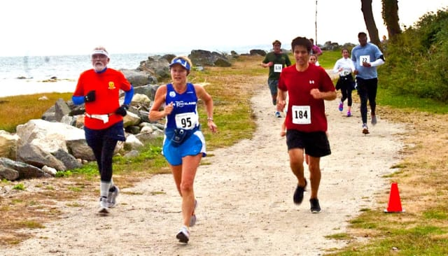 Runners compete at Susannah's Run, part of the Greenwich Cup Series, at Tod's Point last fall.