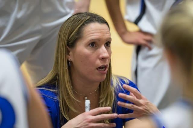 Darien High School girls basketball coach Katie Lauten talks to her team during a timeout.