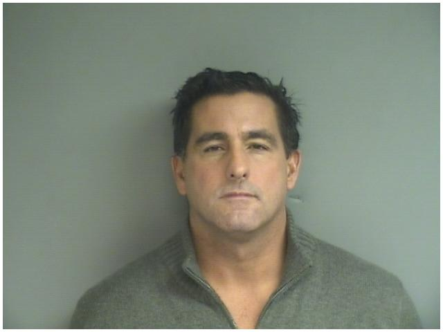 Donato Minicozzi turned himself in to Stamford Police on Monday on harassment and threatening charges.
