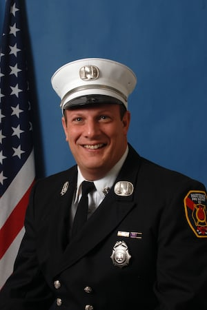 Alcohol poisoning was given as the cause of death for Hartsdale Deputy Fire Chief Joseph Kelley.