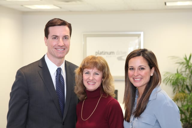Zach Harrison, president and principal broker, Platinum Drive Realty; Gail Fattizzi, executive director, Westchester Real Estate, Inc.; Heather Harrison, co-owner and associate broker, Platinum Drive Realty.