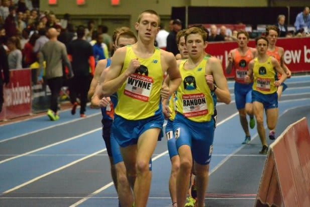 Staples senior Henry Wynne, left, and New Canaan's James Randon, who attends Middlesex School in Massachusetts, run together in Saturday's race in Boston.