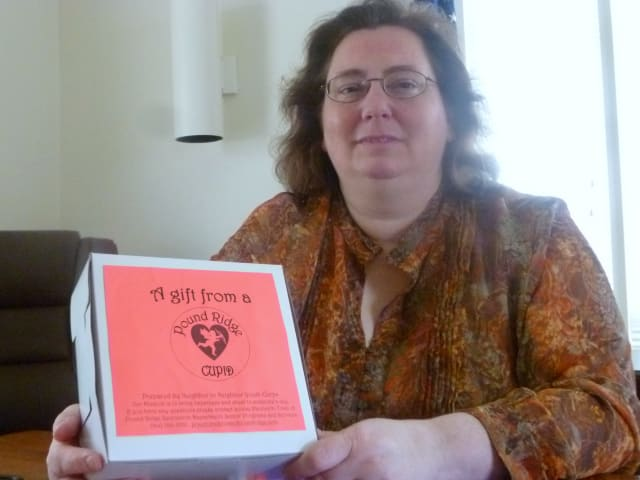 Louise Paolicelli, Pound Ridge  coordinator os senior programs, with one of the Project Pound Ridge Cupid gift boxes.