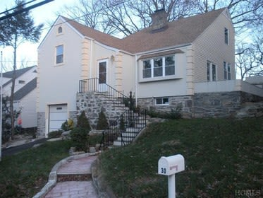 This Gramercy Road home is just one of several that will be featured in Yonkers open houses this weekend.