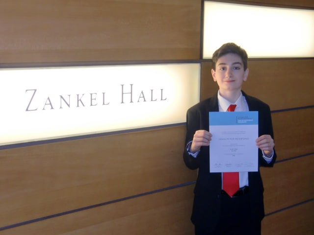 John Peter Redmond shows off his Certificate of Excellence Saturday inside Manhattan's Carnegie Hall, where he performed as one of the top young musicians in the tri-state area.