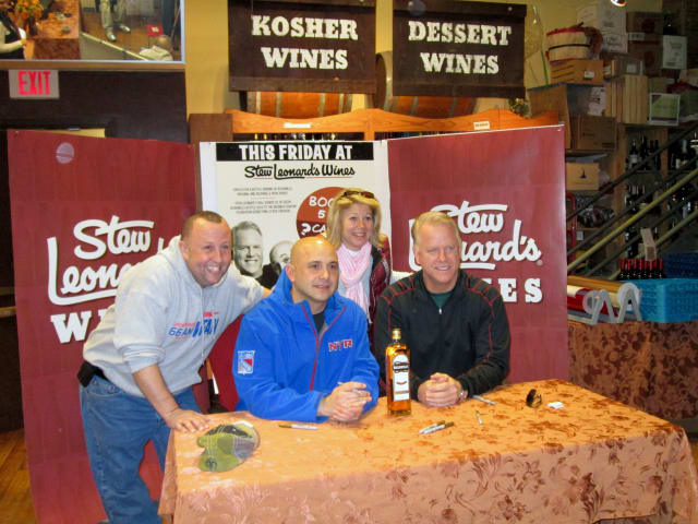 Yonkers resident Sal Fata (left) talked sports with radio show hosts Craig Carton (middle) and Boomer Esiason at Stew Leonard's Wines.