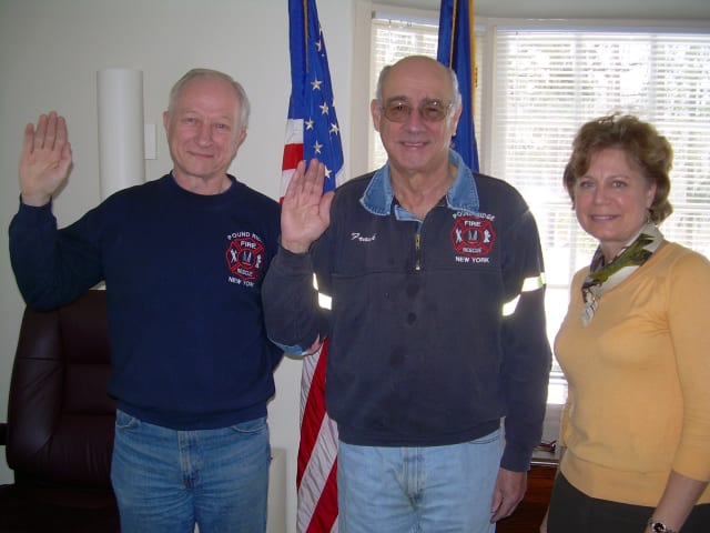 Tom Darold, left, and Frank Sisti are sworn in by Town Clerk Joanne Pace as peace officers - a requirement for becoming fire police.
