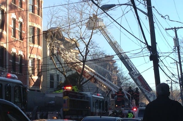 A Saratoga Avenue apartment building was in the process of being demolished Tuesday after a fire the day before.