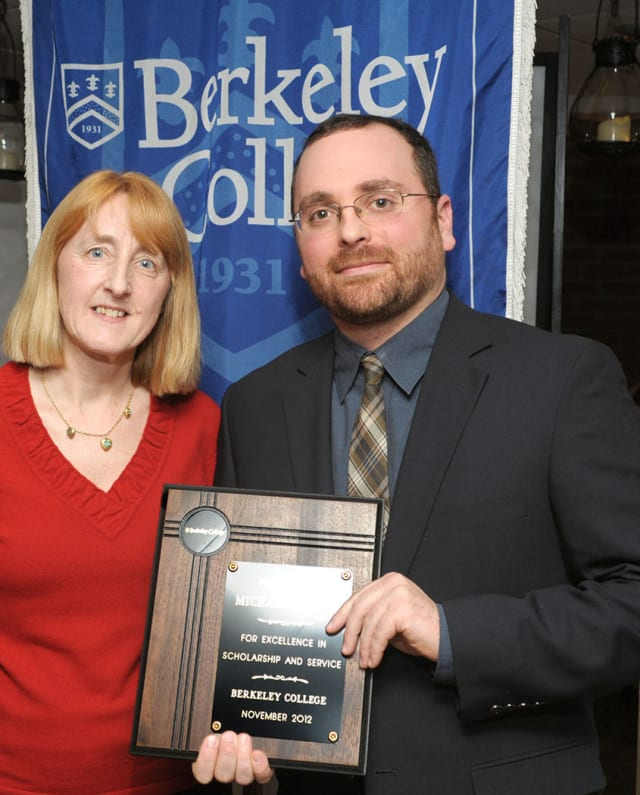Marianne Vakalis, interim provost of Berkeley College, with Dr. Michael Jacobs, of White Plains, recipient of the Faculty of the Year Award.