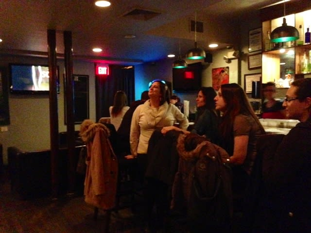 Oscar fans gather at Rainwater Grill in Hastings to watch the awards show.