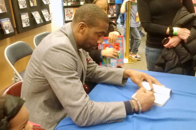 """New York Knicks star Amar'e Stoudemire signs his book, """"STAT,"""" at Barnes & Noble in White Plains on Saturday afternoon."""