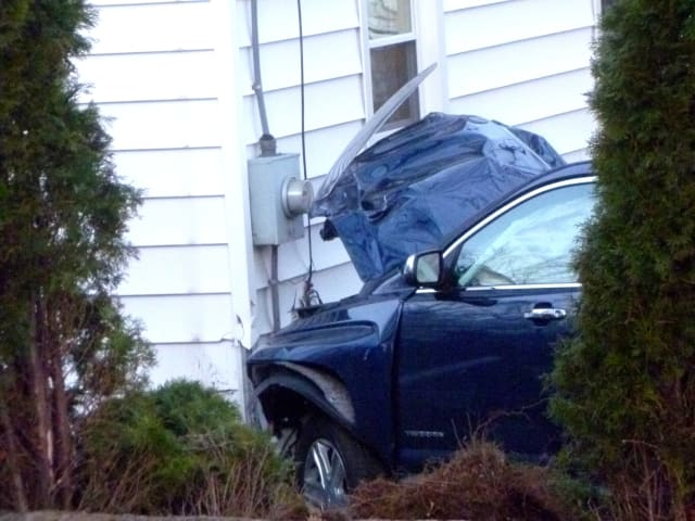 This blue sports utility vehicle smashed into this Stamford home, Tuesday evening.