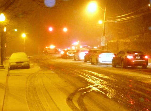 Traffic along Main Street in Hastings slows as condition grow worse after dark Monday.